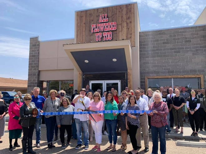 Ribbon Cutting – All Flowered Up Too, 4615 50th St. Holding scissors: owner Jeff Gillespie. Holding ribbon: Chamber Ambassadors Janie Zuniga, left, and Tammy Hamersley. Also pictured: Lubbock Chamber Ambassador Chairman Dalton Jantzen, owner Stacey Gillespie, and other staff, friends and Chamber Ambassadors.
