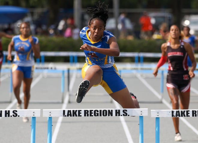 Auburndale senior Tyra Thomas runs to victory in the 300 hurdles on Saturday in the Class 3A, District 7 track and field meet at Lake Region High School.