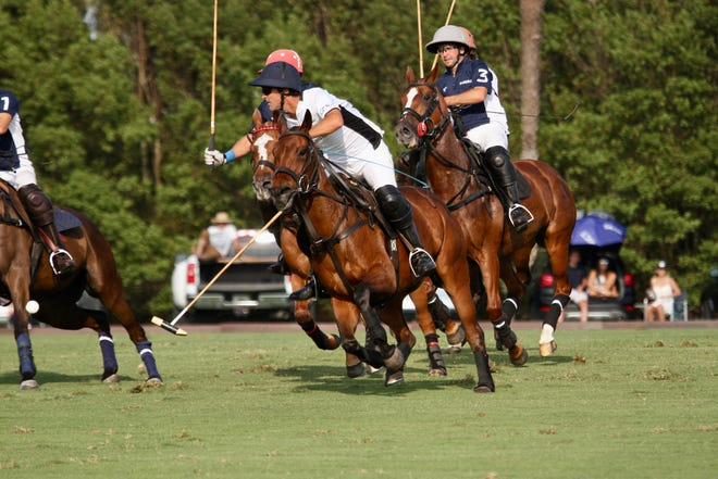 MVP Pablo MacDonough of Richard Mille steals the ball and heads to the goal during the season finale of the World Polo League.