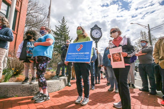 Warren residents and supporters rally on Sunday at Town Hall to decry the white supremacist stickers found recently in the Water Street area.
