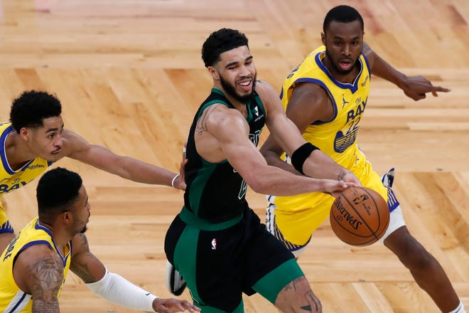 Boston Celtics' Jayson Tatum, center, passes off against Golden State Warriors' Jordan Poole, left, Kent Bazemore, second from left, and Andrew Wiggins (22) during the second half of an NBA basketball game, Saturday, April 17, 2021, in Boston. (AP Photo/Michael Dwyer) ORG XMIT: NYOTK