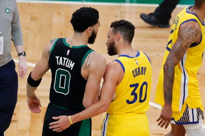Boston Celtics' Jayson Tatum (0) and Golden State Warriors' Stephen Curry (30) talk following an NBA basketball game, Saturday, April 17, 2021, in Boston. (AP Photo/Michael Dwyer) ORG XMIT: MAMD115