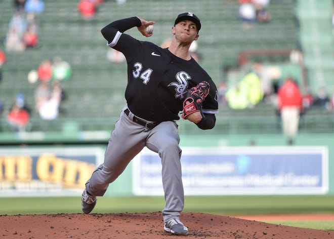 Michael Kopech, the former Red Sox draft pick who was traded to Chicago in the Chris Sale deal, pitches for the White Sox at Fenway Park on Sunday evening.