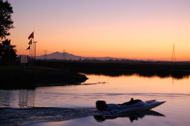Sunsets over Mt. Diablo, seen from Village West Marina, Stockton.