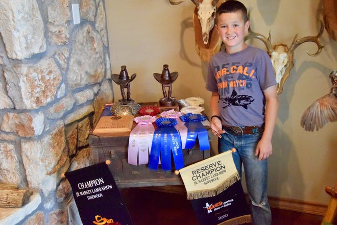 10-year old Royce Cook is only in his 2nd year of showing sheep and goats on the majors circuit but he's already building his collection of awards, including banners from Houston and San Antonio.
