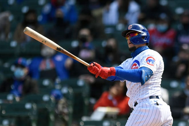 Chicago Cubs shortstop Javier Baez watches his three-run home run during the third inning against the Atlanta Braves on Saturday in Chicago.