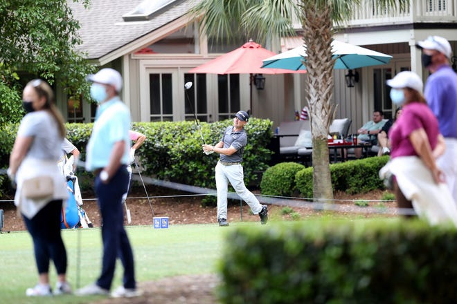 Fans watch as Brian Harman, a Savannah native, hits his tee shot on the fifth hole Sunday during the final round of the RBC Heritage at Harbour Town Golf Links on Hilton Head Island, S.C.