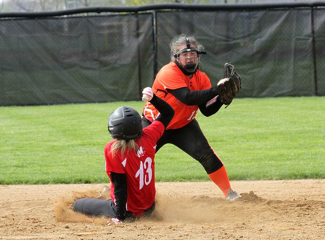 Sturgis shortstop Sydney Johnson brings in a throw to record an out on Colon's Alissa Jacobs at second base on Saturday.