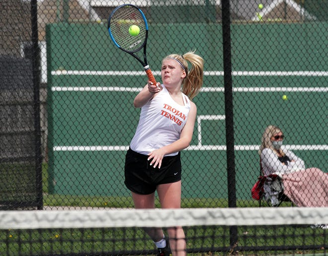 Rylee Carver of Sturgis returns a shot in one of her matches on Saturday.