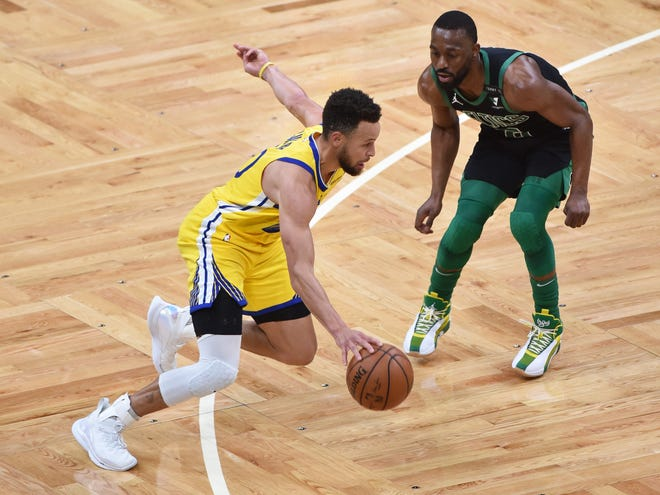 Celtics guard Kemba Walker, right, guards against Warriors guard Stephen Curry during the first half Saturday night at TD Garden.