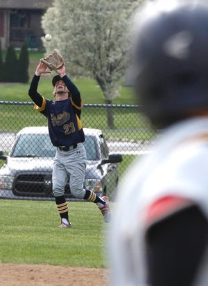 Charlie Drumm makes a catch in left field.