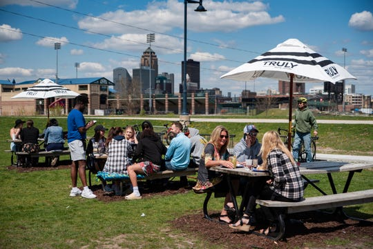 Patrons enjoy outdoor food and drinks on April 18, 2021 at Mullet's in Des Moines.
