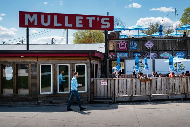 Patrons enjoy outdoor food and drinks on April 18 at Mullet's in Des Moines.