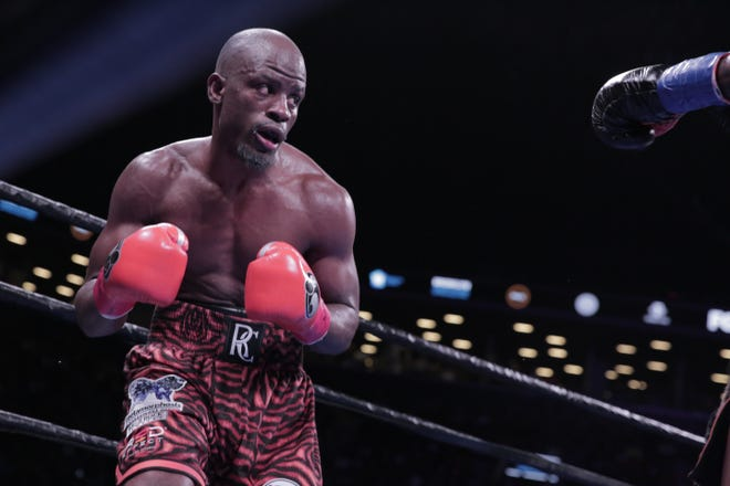 FILE - In this Dec. 2018 file photo, Tony Harrison fights against Jermell Charlo. Harrison fought to a split decision in Saturday night's bout against Bryant Perrella after a 16-month layoff.