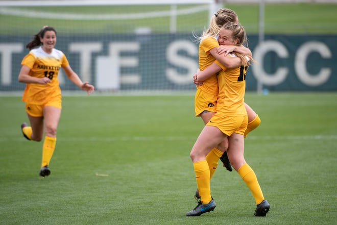 Iowa forward Jenny Cape (19) celebrates scoring the opening goal with Iowa midfielder Hailey Rydberg (2) during the final of the Big Ten Conference soccer tournament April 18 in State College, Pennsylvania.
