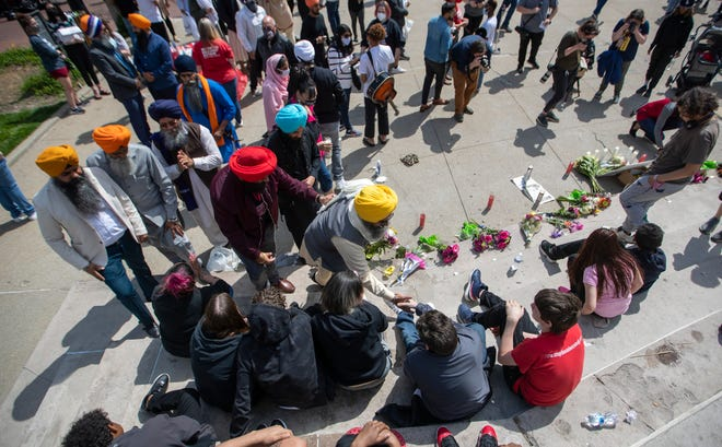 Members of the Sikh community embrace family and friends of shooting victim Karli Smith on Sunday, April 18, on Monument Circle during a vigil for the eight people who were recently killed in an overnight shooting at a Fed Ex Ground Plainfield Operations Center on Indianapolis' southwest side.