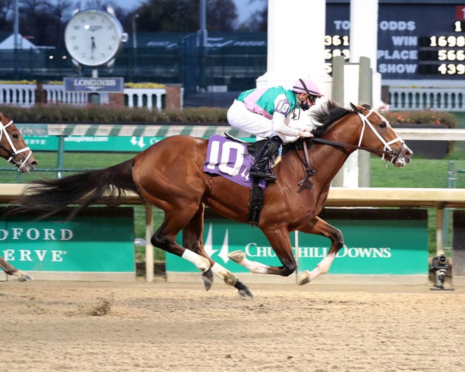 Mandaloun and jockey Florent Geroux win an optional claiming race at Churchill Downs on Nov. 28, 2020. (Photo courtesy of Coady Photography.)