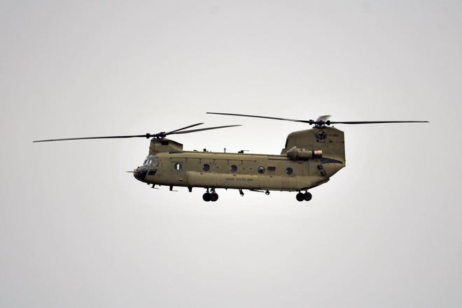 A Chinook helicopter flies by during the 2021 Thunder Air Show at Bowman Field, Saturday, Apr. 17, 2021 in Louisville Ky.