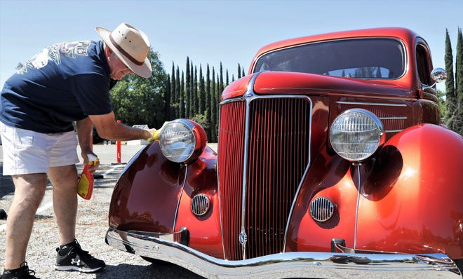 Jack Erbland of Redding applies a coat of show and shine brand of car wax to his 1936 Ford during the Elks Running on Empty Car Show on Sunday, April 18, 2021. The show was part of the weeklong Shasta Show and Shines being held in the Redding area as an alternative to the canceled Kool April Nites.