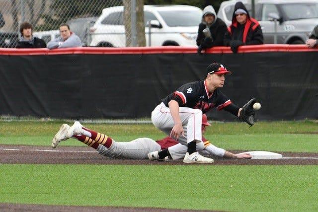 Brandon Valley first baseman Peyton Carroll attempts to tag Roosevelt's Dane Mediger on Friday, April 16, 2021.