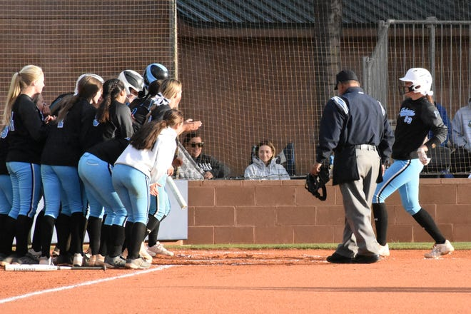 Canyon View celebrates after Kamryn Allen hits a home run against Snow Canyon.