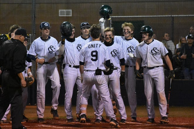 Snow Canyon celebrates a home run by Landon Frei (9) during a game against Desert Hills.