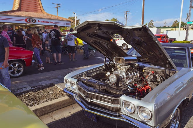 """The downtown Visalia A&W Restaurant is closing after 54 years on Willis Street. Hundreds turned out for one final """"Cruise Night,"""" featuring dozens of hot rods and classic cars."""
