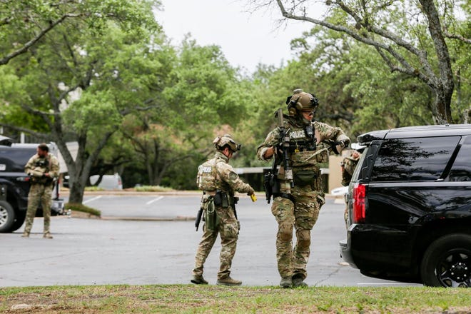 Austin police, SWAT and medical personnel respond to an active shooter situation located Great Hills Trail in Northwest Austin on Sunday, April 18, 2021.