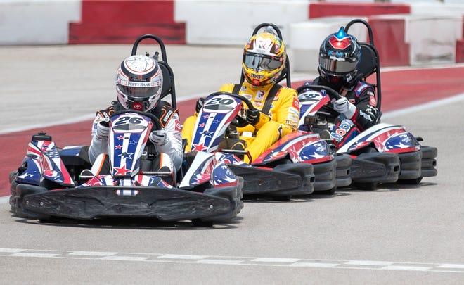 NASCAR drivers, from left, Daniel Hemric, Kyle Busch and John Hunter Nemechek race the go-karts on Monday before discussing the upcoming race at the Circuit of the Americas in May.