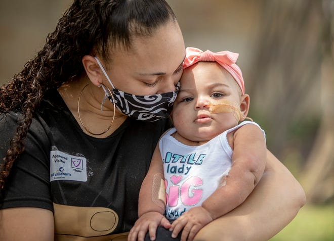 Olivia Guthrie cuddles with her 6-month-old daughter, Zaria Grace Jackson, on Monday outside Dell Children's Medical Center of Central Texas. Zaria went home Monday after recovering from a heart transplant.