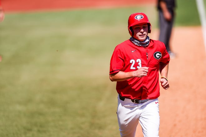 Connor Tate, an Oconee County graduate, jogs to home plate to score a run during Sunday's game against Kentucky. (UGA Sports Communications