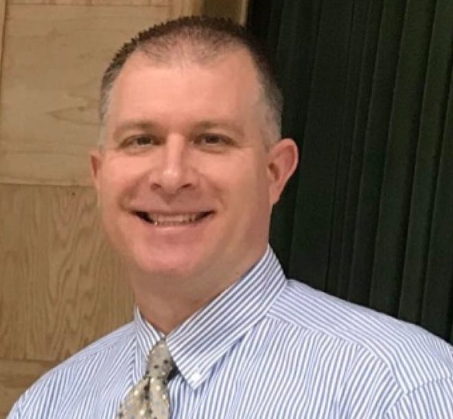 Bradley Beun, Springfield Local School District's director of special services, was arrested Friday after being accused of soliciting an undercover FBI employee to have sex with an 8-year-old girl.