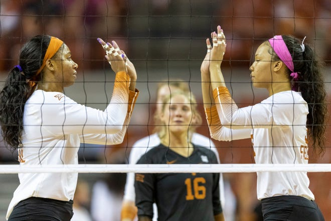 Texas middle blocker Asjia O'Neal, left, and outside hitter Skylar Fields prepare to compete against Texas Tech last October. The Longhorns defeated Nebraska in the Elite Eight on Monday to advance to the Final Four for the first time since 2016.