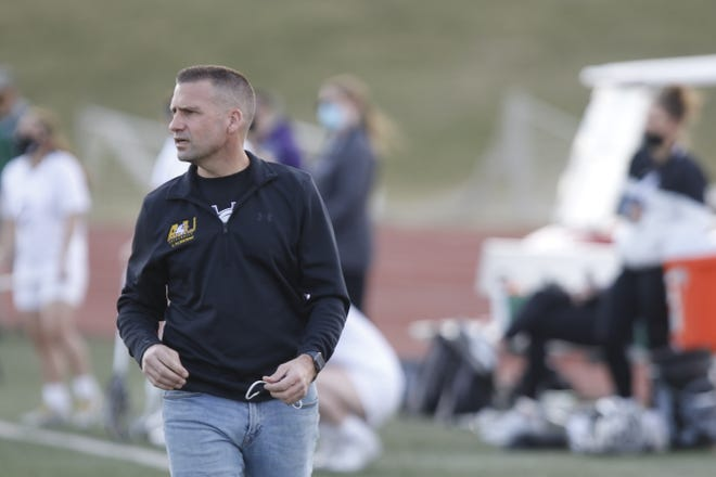 Ashland women's lacrosse interim coach Mike Jewell watches his team during a game earlier this season.