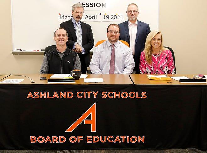 Ashland City School Board members (seated l-r) Brandon Wells, Zach Truax, Gina Deppert, (standing l-r) Dr. James Wolfe and Dr. Fred Gingerich on Monday April 19, 2021. TOM E. PUSKAR/TIMES-GAZETTE.COM