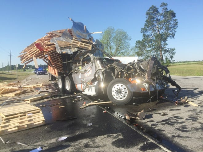 A Louisville man was killed Monday morning when two trucks collided on U.S. Highway 1.
