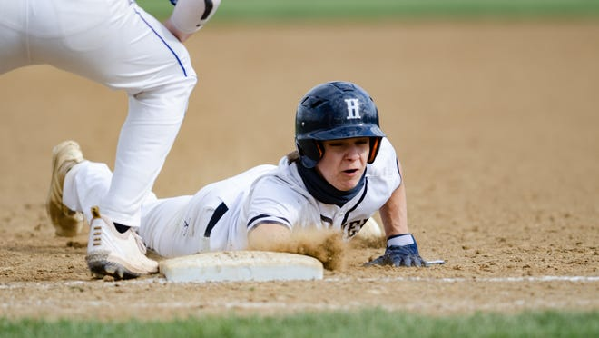 Hopewell's Luke Kerec dives back to first to avoid a pickoff against Ellwood City on Monday afternoon at Hopewell's Joe Colella Field.
