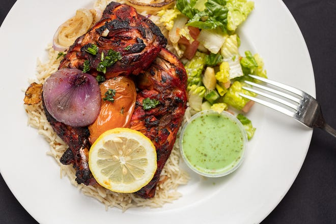 Chicken leg & thigh with rice and salad at Jasmine Fusion Cuisine
