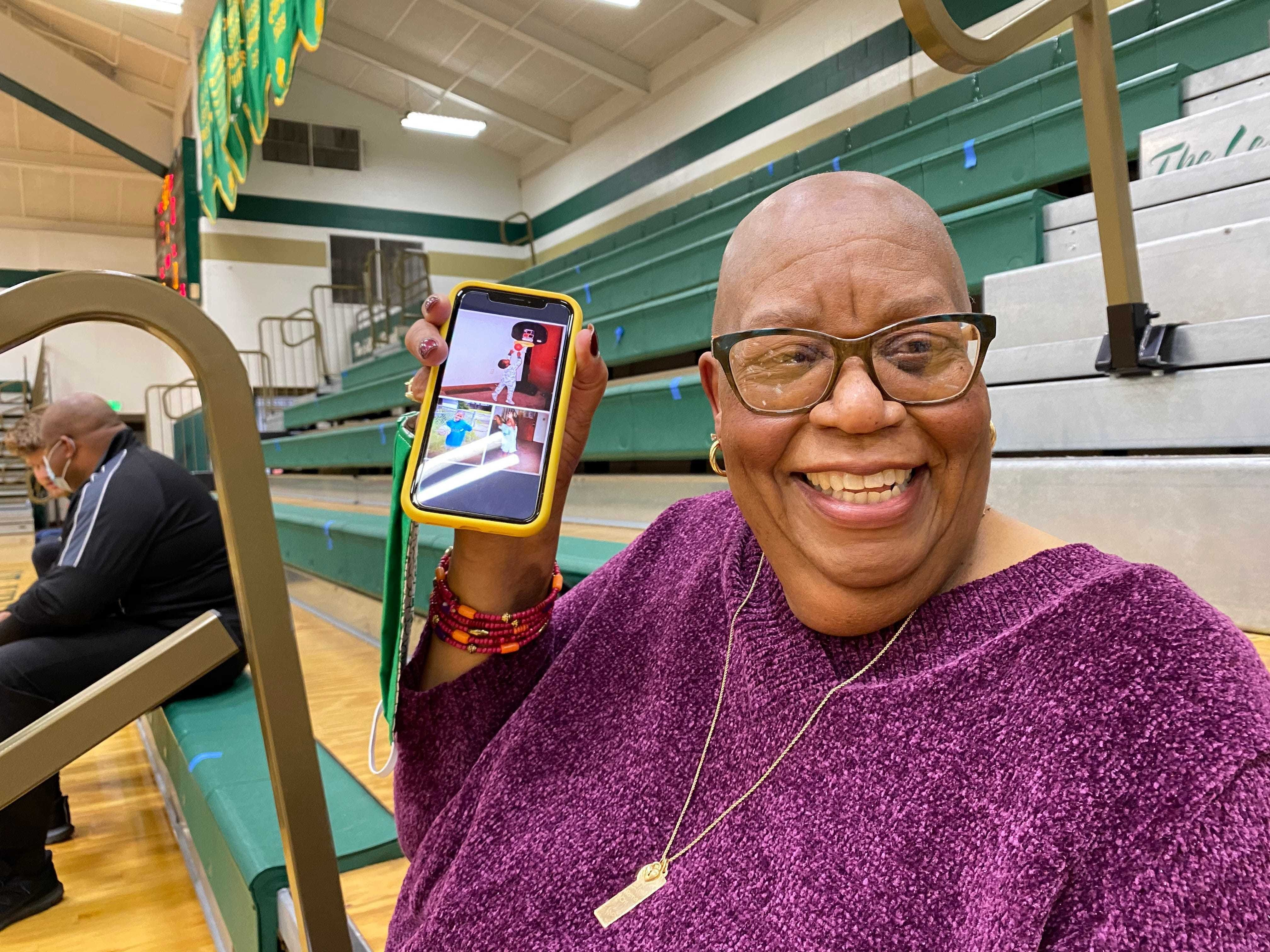 Malaki Branham's grandmother, Luzon, shows a photo collage of her grandson after he signed to play basketball for Ohio State.