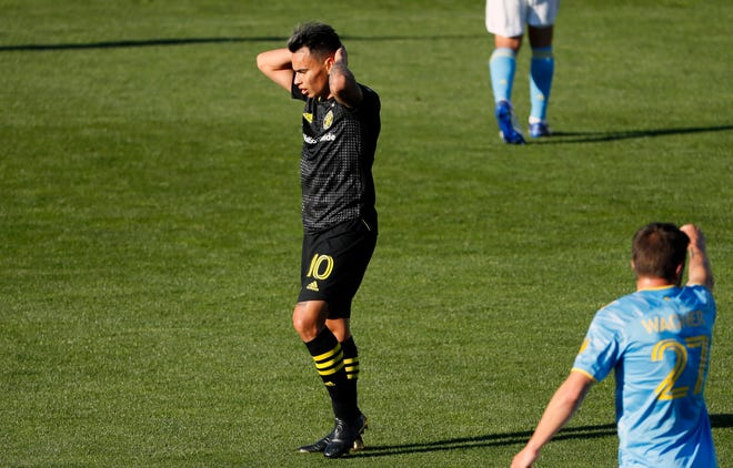 Columbus Crew SC midfielder Lucas Zelarayan (10) reacts after his shot hit off the cross bar against Philadelphia Union during the first half of their MLS game at Historic Crew Stadium in Columbus, Ohio on April 18, 2021.