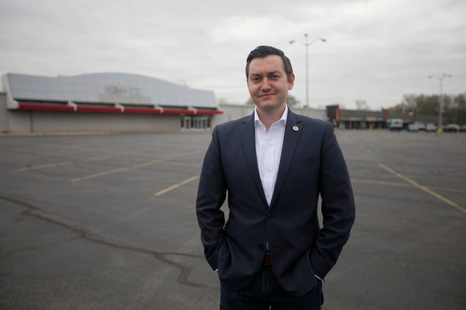 Andrew Bowsher, Reynoldsburg development director, at the site of a proposed $200 million development by the Christian and Missionary Alliance, where a vacant Kmart currently stands at the corner of Brice Road and Main Street.