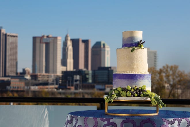 Kittie's Cakes—recently acquired by The Fives' parent company, Together & Company—opted for an ombre motif in buttercream, set off by fresh herbs and flowers, for its rooftop confection.