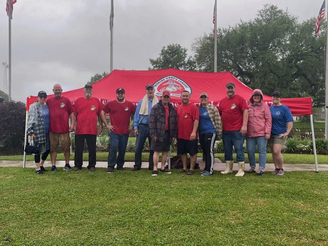 Members of the Marine Corps League and PNP Norma A. Liner Unit of the Marine Corps League Auxiliary braved the rain Saturday to clean up Roger D. Songe Veterans Memorial Park in Houma.