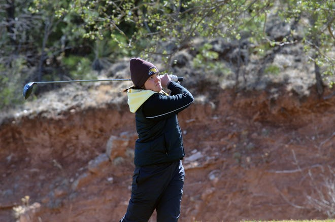 Abby Stender watches her drive during the Hardrocker Invite in Rapid City, S.D. April 13. Stender and the Minnesota Crookston women's golf team finished 13th at the Augustana Spring Invite.