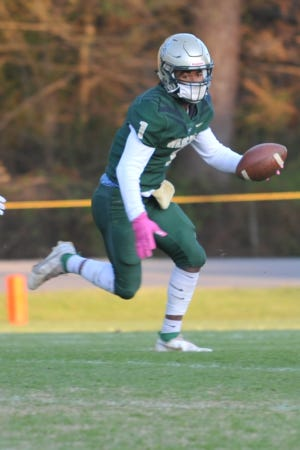 Eastern Randolph's Osiris Ross, shown here returning a kickoff against Randleman,  caught 6 passes for 134 yards and a touchdown against Clinton. He also scored on an 8-yard run in the first overtime. [Mike Duprez/Courier-Tribune]