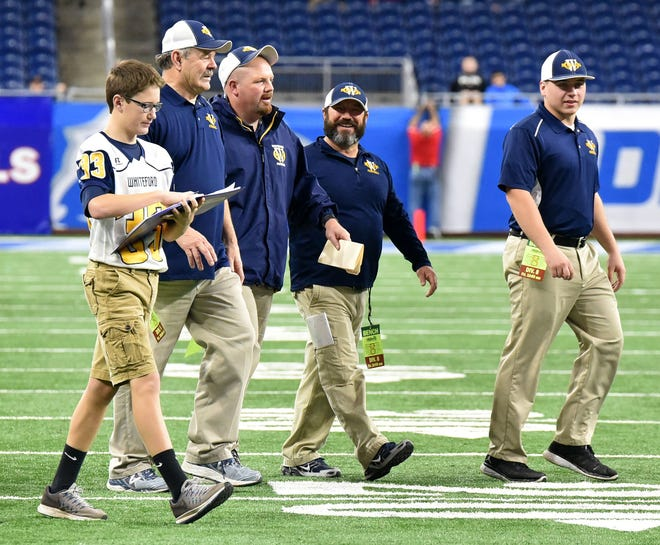 Cole Giesige, Bob Ondrovick, Jason Mensing, John Nagle and Kevin Kaufman of Whiteford leave the field Friday. Whiteford beat Saginaw Nouvel 42-21 at Ford Field in Detroit.