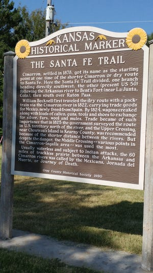 The Kansas Historical Marker about the Santa Fe Trail is located in the back side of the Cimarron city park.