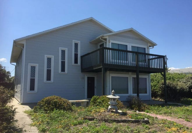 Direct oceanfront views abound from this two-story Flagler Beach home, which features a front balcony and a spacious open porch beneath.