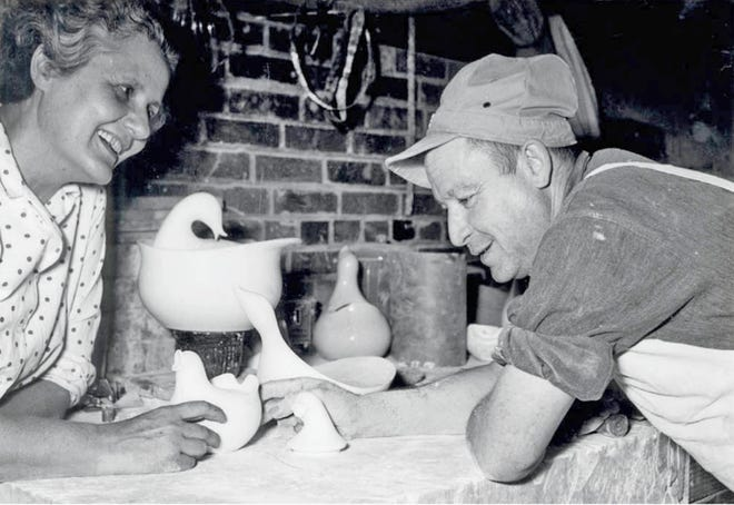Eva Zeisel discusses her bird-shaped wares with one of Western Stoneware's model makers in 1953.