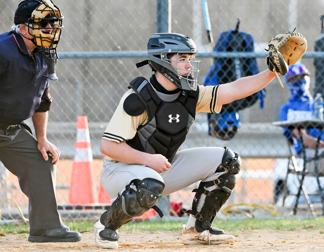 Western Wayne catcher Luke Janiszewski is enjoying a banner sophomore season behind the dish and with the bat. He's pictured here handling pitches during recent Lackawanna League Division III action.